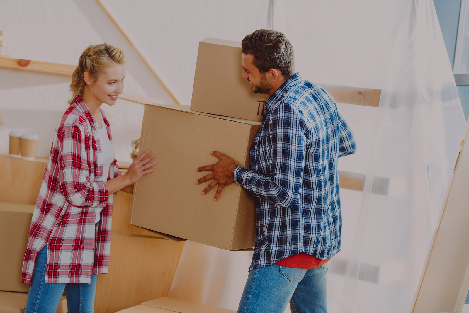happy young couple moving house - darker